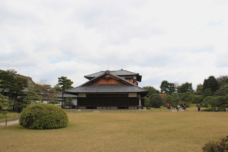 flatland: Kyoto, Japan - April 11, 2015: Nijo Castle, a flatland castle in Kyoto, is one of the seventeen Historic Monuments of Ancient Kyoto designated by UNESCO as a World Heritage Site. Editorial