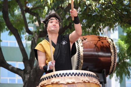 impingement: Los Angeles, California, USA - August 16, 2015: Japaneses are performing Japanese percussion instruments at Nisei Week Japanese Festival in Little Tokyo, Los Angeles. Editorial
