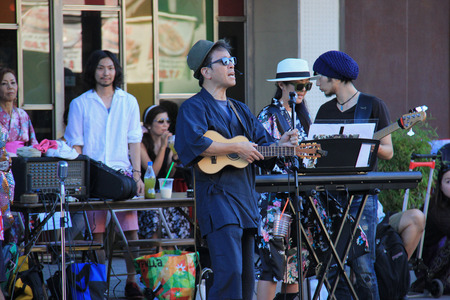 entertain: Los Angeles, California, USA - Musicians are playing music beside the street to entertain people who are waiting to see Nisei Week Japanese Festival Parade.