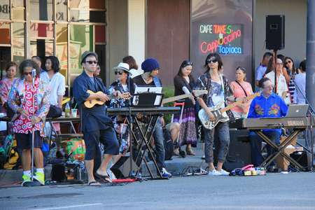 Los Angeles, California, USA - Musicians are playing music beside the street to entertain people who are waiting to see Nisei Week Japanese Festival Parade.