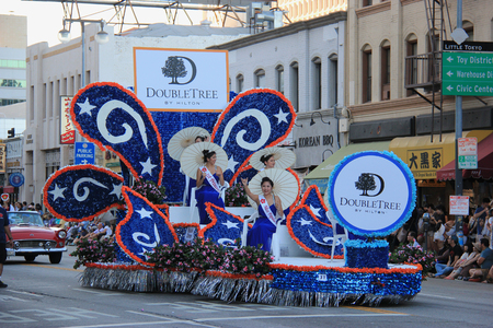 Los Angeles, California, USA - August 16, 2015: Hawaii Cherry Blossom Festival Queen and Court on the float of Nisei Week Japanese Festival Parade at Little Tokyo in Downtown Los Angeles.