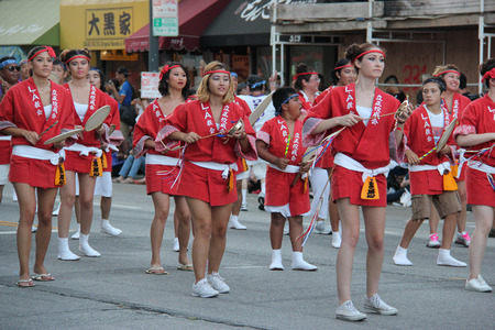 historical landmark: Los Angeles, California, USA - August 16, 2015: Parade of Nisei Week Japanese Festival, the festival for Second Generation Japanese-American, is held at Little Tokyo in Downtown Los Angeles.