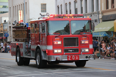 joins: Los Angeles, California, USA - August 16, 2015: The Los Angeles Fire Department, the third largest municipal fire department in the United States, joins Nisei Week Japanese Festival 2015 at Little Tokyo in Downtown Los Angeles.