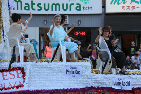 dramatics: Los Angeles, California, USA - August 16, 2015: Nisei Week Queen and Court on the float of Nisei Week Japanese Festival Parade at Little Tokyo in Downtown Los Angeles. Editorial