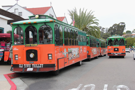 tramcar: San Diego, California, USA - May 25, 2015: Old Town Trolley Tour of San Diego offers tourists sightseeing tours in Old Town San Diego Area, the oldest settled area in San Diego.