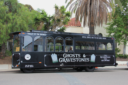doomed: San Diego, California, USA - May 25, 2015: Old Town Trolley Tour of San Diego offers tourists sightseeing tours in Old Town San Diego Area, the oldest settled area in San Diego.