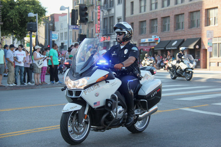 municipal editorial: Los Angeles, California, USA - August 16, 2015: Los Angeles Police Department, the third largest municipal police department, participates in Nisei Week Japanese Festival Parade 2015.