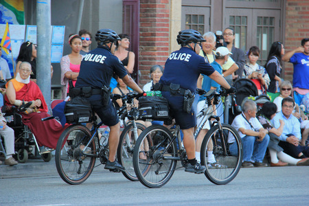 municipal editorial: Los Angeles, California, USA - August 16, 2015: Police from Los Angeles Police Department, the third largest municipal police department, patrol during Nisei Week Japanese Festival Parade 2015. Editorial