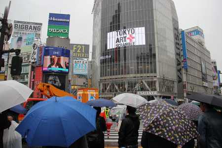 cuisine entertainment: Tokyo, Japan - April 13, 2015: Pedestrians are waiting for the traffic light to cross the Shibuya crossing, the worlds busiest intersection, in Tokyo, Japan.