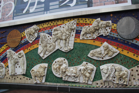well known: Tokyo, Japan - April 13, 2015: Wall Decoration about Hachiko, an Akita dog which is remembered for his remarkable loyalty to his owner, at the Shibuya Station.
