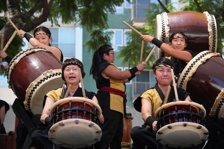 Los Angeles, California, USA - August 16, 2015: Japaneses are performing Japanese percussion instruments at Nisei Week Japanese Festival in Little Tokyo, Los Angeles. Editorial