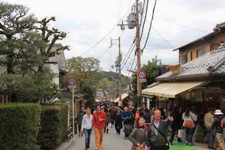 Kyoto, Japan - April 11, 2015: Tourists enjoy shopping along the street toward Ginkaku-ji or Silver Pavilion in Kyoto, Japan. Editorial