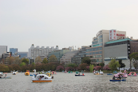 Tokyo, Japan - April 12, 2015: People are having a good time with nautical activities at Boat Pond, one of 3 sections of Shinobazu Pond in Ueno Park, Tokyo, Japan.