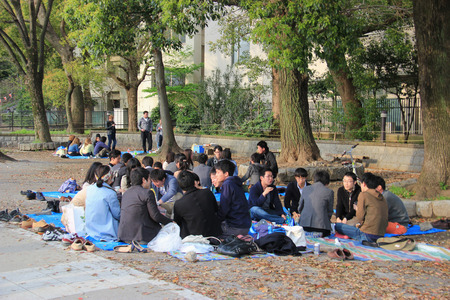 Tokyo, Japan - April 12, 2015: Many people are relaxing at Ueno Park, a large public park in central Tokyo.