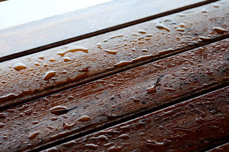Droplet of water on wood and sunlight after rain, high durable material for using long lasting material furniture for safety and save money, with space for write wording