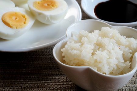 Sticky rice or glutinous rice and boiled eggs served in restaurant, high vitamin, mineral such as selenium, copper and phosphorous food useful for human growth, tradition Thai food and export product Zdjęcie Seryjne
