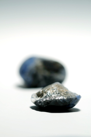 Isolated picture of broken lucky stone on white background, devalue and unlucky object, with space for write wording