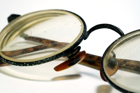 Isolate photo of old dirty damage eyeglasses with space for write wording, dangerous eye ware high risk of infection, major cause of blindness that affect quality of living, economy and health problem
