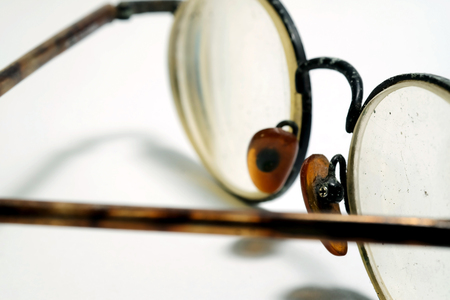 Isolate photo of old dirty damage eyeglasses with space for write wording, dangerous eye ware high risk of infection, major cause of blindness that affect quality of living, economy and health problem Reklamní fotografie