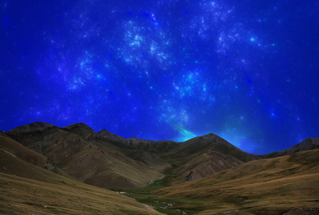 upland: Fantastic star sky at night in mountain valley Stock Photo
