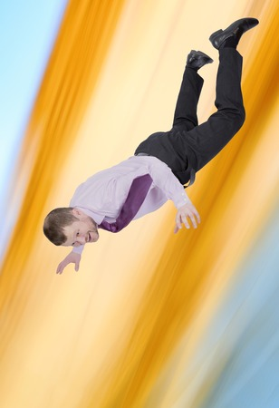 falling down: Businessman falling down with abstract background Stock Photo