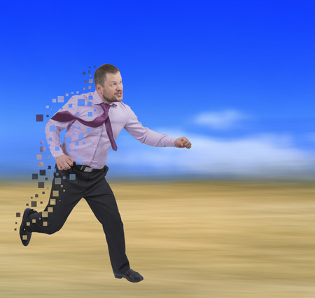 lateness: Running businessman in a hurry on blurred background