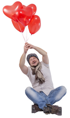 man flying: Young man flying on balloons on white background Stock Photo
