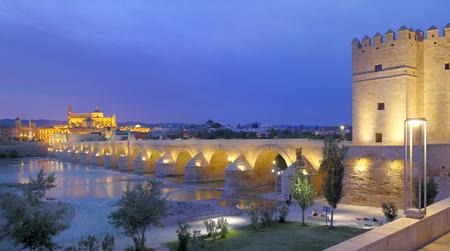 nite: Cathedral Mezquita and Roman bridge at sunset, Guadalquivir river, Cordoba, Andalusia, Spain