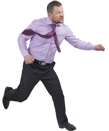 lateness: Running businessman in a hurry on white background Stock Photo