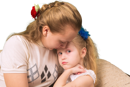 emotional love: Elder sister consoles the younger isolated on white background