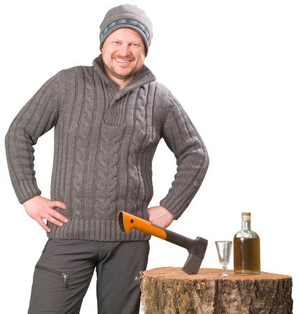 forester: Forester in winter clothing with axe and bottle of alcohol smiling isolated on white backhround Stock Photo
