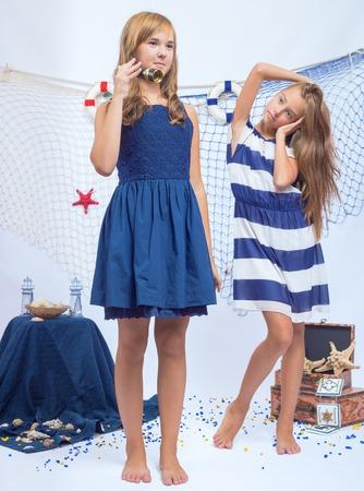 ocean fishing: Two beautiful teen girls with small telescope