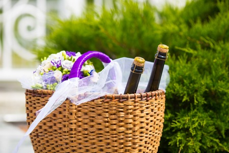 champaign: Wicker basket with two bottles champaign and flowers