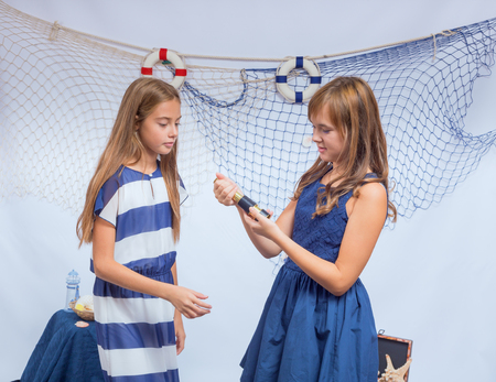 beautiful teen: Two beautiful teen girls with small telescope