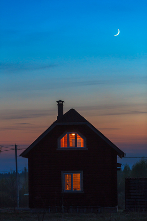 wooden house exterior with lights night view