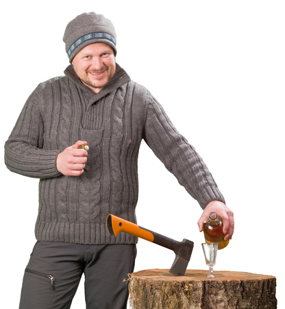 forester: Forester in winter clothing with axe and bottle of alcohol smiling