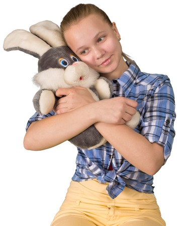 plush toy: Teen girl embracing the plush toy hare
