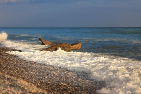 storm tide: Seashore with breakewater sea storm sky tide