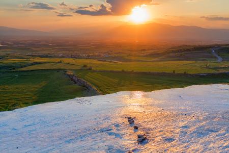 glance: Sunset at the valley with glance surface on foreground Pamukkale Turkey