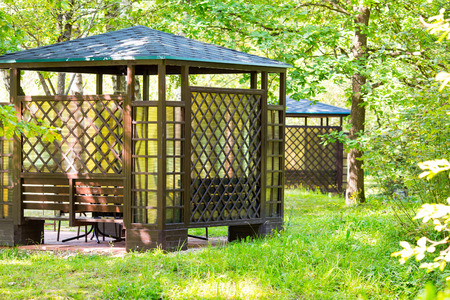 comfortable: Comfortable arbour in the park green forest Stock Photo