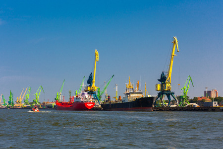 KLAIPEDA, LITHUANIA - AUGUST 12, 2015:    Klaipeda seaport with cargo ships and cranes