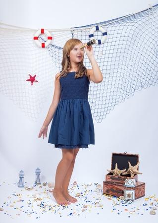 beautiful teen: Beautiful teen girl looking in telescope with fishing net
