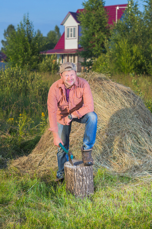 village man: Village man have a rest near the haystack Stock Photo