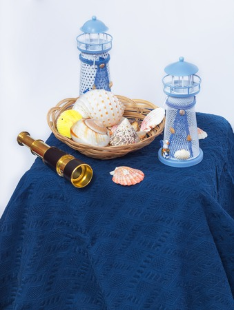 beacons: Still life with seashells small telescope and beacons Stock Photo