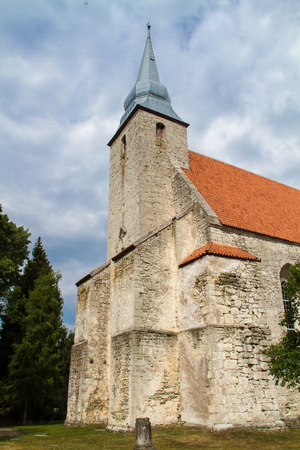 cloude: Old catholic stone church with cloude sky