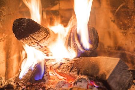 fire wood heat: Firewood burning fireplace fire wood heat interior Stock Photo