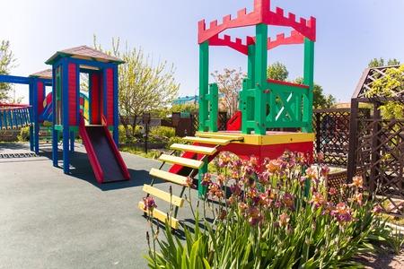 children play: Kids playground children play site recreation equipment Stock Photo