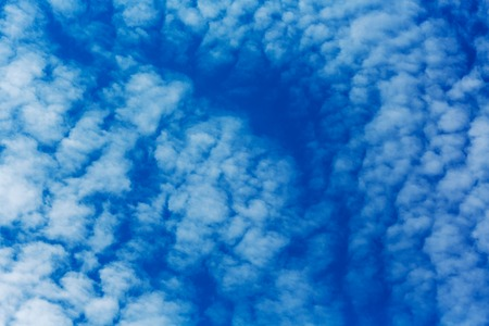 soothe: Peaceful white clouds at deep blue sky Stock Photo