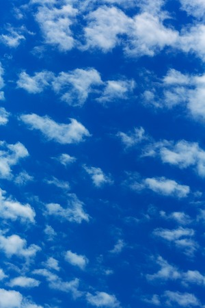 quietude: Peaceful white clouds at deep blue sky Stock Photo