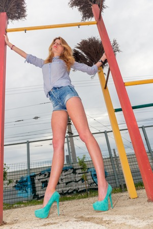 urban style: Young beautiful woman in shorts urban style